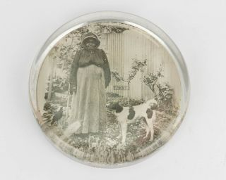 A glass paperweight featuring a photographic portrait of Fanny, an Indigenous Australian woman....