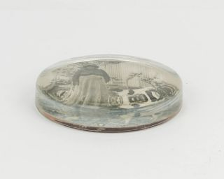 A glass paperweight featuring a photographic portrait of Fanny, an Indigenous Australian woman