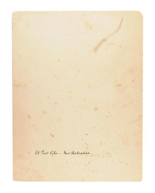 An original gelatin silver photograph (110 x 90 mm) mounted on stiff card (220 x 170 mm), inscribed in white ink on the mount beneath the photograph: 'With Christmas Greetings from Dr and Mrs Ramsay Smith'. It is stamped on the rear 'Photo. by Dr. W. Ramsay Smith' and captioned in his hand 'At Port Vila - New Hebrides'