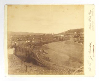 Four large albumen paper photographs of the Broken Hill region. The photographs, each approximately 200 × 225 mm, are on the original glossy cream-coloured mounts with the imprint of the photographer, 'G.F. Jenkinson, Areas Photo Coy, Argent Street, Broken Hill'