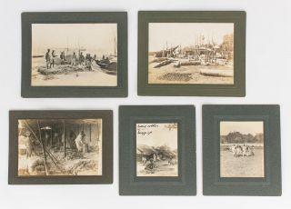 A group of eleven vintage gelatin silver photographs (circa 1920s) mounted individually on commercial blind-embossed cards; the photographer is not identified
